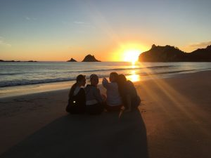 Students enjoying the sunset after cleaning Mt Maunganui Beach
