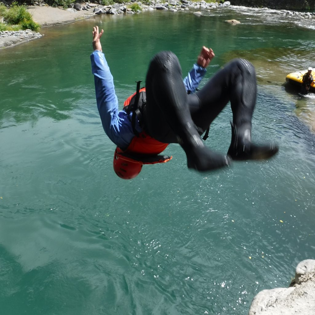 Enjoying the optional river jump with Tongariro River Rafting